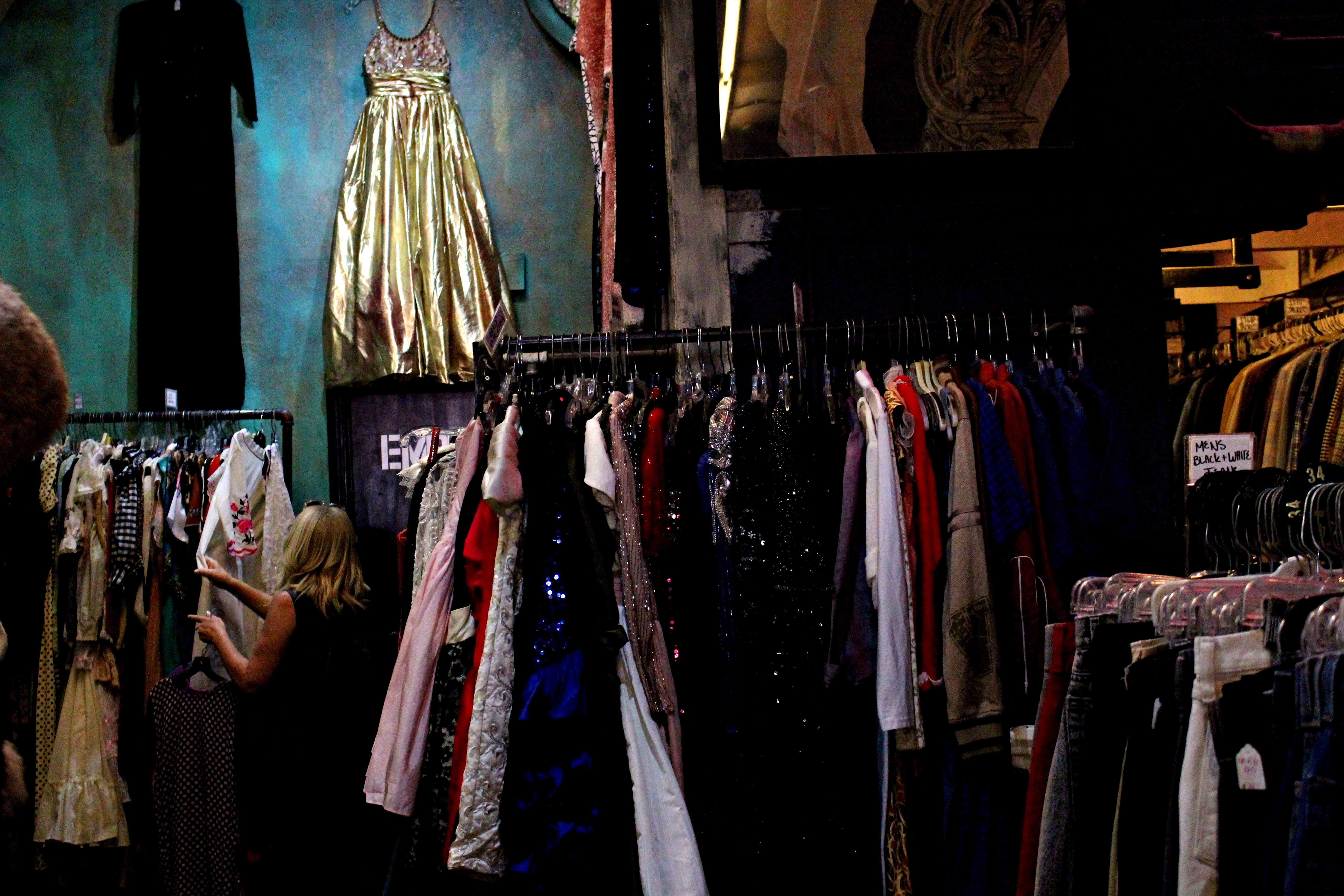 A customer looks around in the costume section. Credit: Fiona Belk / M-A Chronicle.